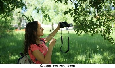 a young girl makes a selfie for the camera. To pose for the camera. Fun outdoors