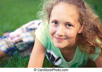 a young girl on green grass