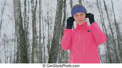 A young girl on the morning jog holds in her hands a...