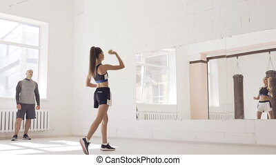 A young girl performs a coach's task for coordination and ...