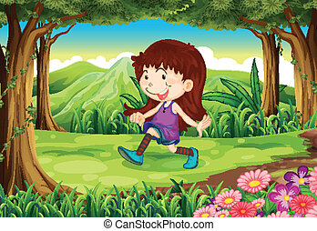 A young girl playing at the forest