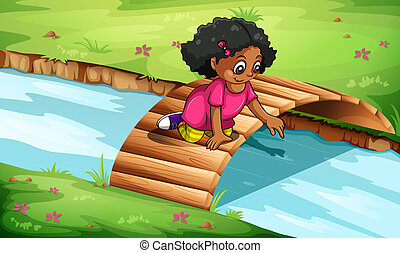 A young girl playing at the wooden bridge