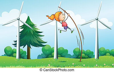 A young girl playing near the windmills