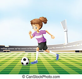 A young girl playing soccer at the field