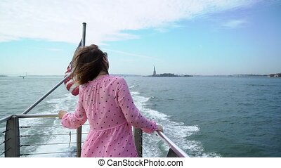 A young girl rides a ship on the Hudson. Boat trip around New York city, USA.