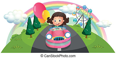 A young girl riding in a pink car with balloons