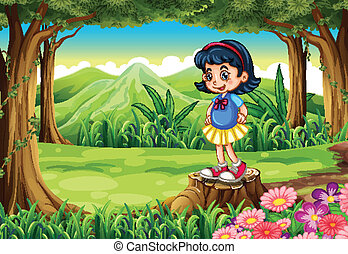 A young girl standing above the stump