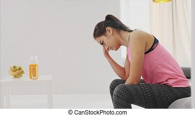 A young girl tired of physical exercises went to rest. Got a...