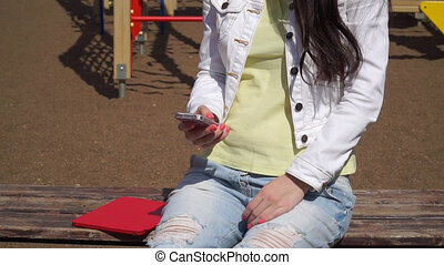 a young girl uses the app on your smartphone