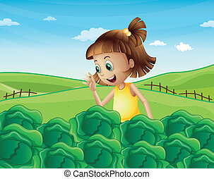 A young girl watching the growing vegetables at the farm -...