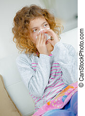a young girl with cold
