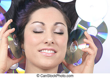A young girl with DVDs record lay on the ground
