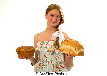 A young girl with fresh bread in the hands of