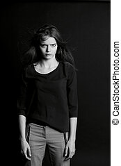 young girl with long hair. Daring look in . BW - A young ...