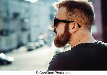 young guy with a beard and glasses