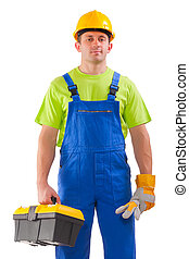 a young handsome plumber worker with adjustable wrench....