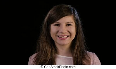 A Young Lady Smiling Against a Black Background