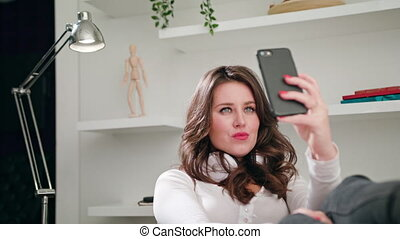 A Young Lady Taking Selfie Indoors