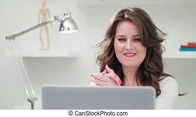 A Young Lady Using a Computer Indoors