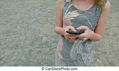 A Young Lady Using a Mobile Phone Outdoors