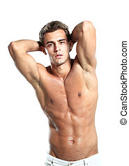a young male model posing his muscles