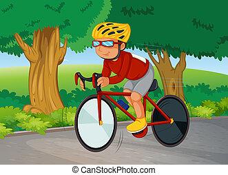 A young man biking