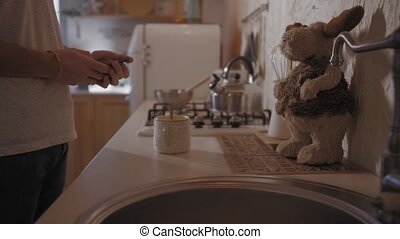 A Young Man Comes to the Kitchen in the Morning. He Picks up a Takes of Coffee from the Table