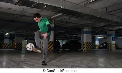 A young man doing professional football tricks on the...