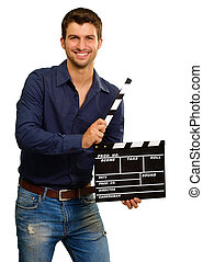 A Young Man Holding A Clapboard