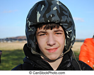 A young man in a helmet