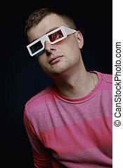 A young man in anaglyph glasses