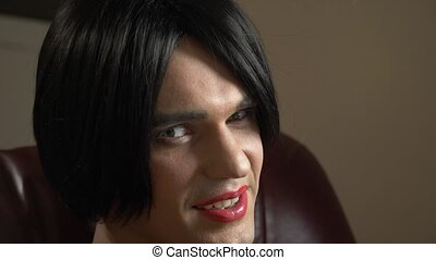 a young man in the image of a transsexual seductively...