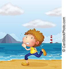A young man jogging along the beach