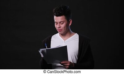 A Young Man Mimicing Against a Black Background