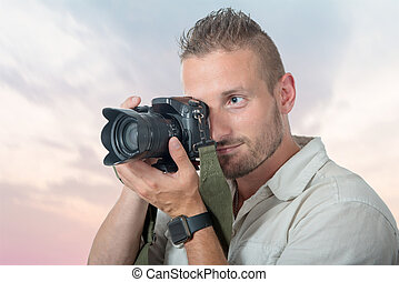 young man photographer with dslr camera