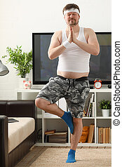 A young man practicing yoga and Pilates