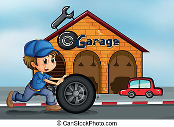 A young man pushing the tire in front of the garage