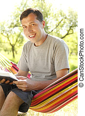 a young man reading the Bible