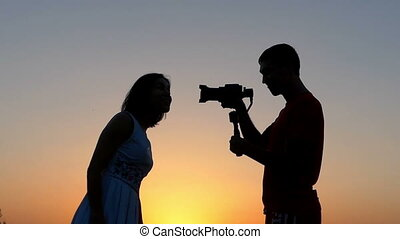 a Young Man Shoots a Laughing Woman With His Camera at...
