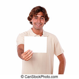 A young man smiling holding a card.
