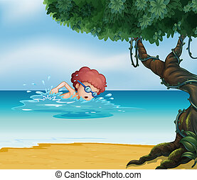 A young man swimming at the beach with an old tree