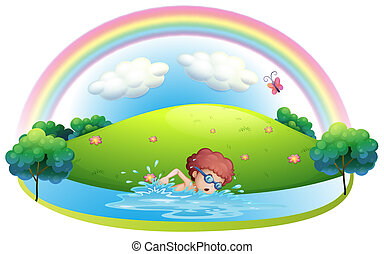 A young man swimming near the hill with a rainbow