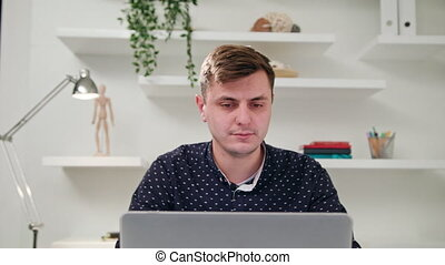 A Young Man Using a Computer Indoors