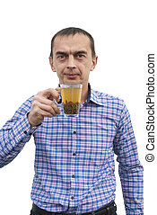 A young man with a cup of green tea in hand