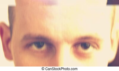 a young man with brown eyes looking into the camera,computer...