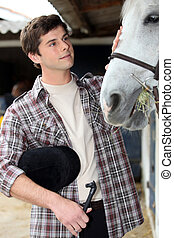 A young man with his horse