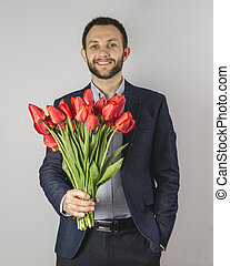 a young man with red flowers