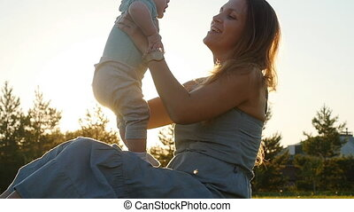 A young mother holding a little son in her arms