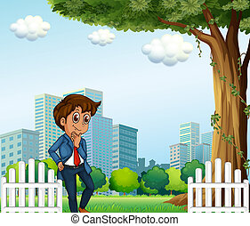 A young office worker near the wooden fence