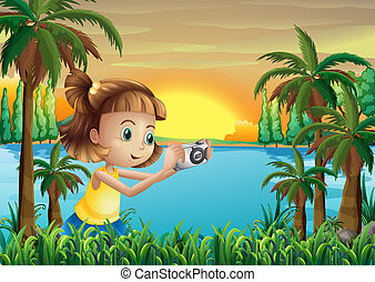 A young photographer at the riverbank